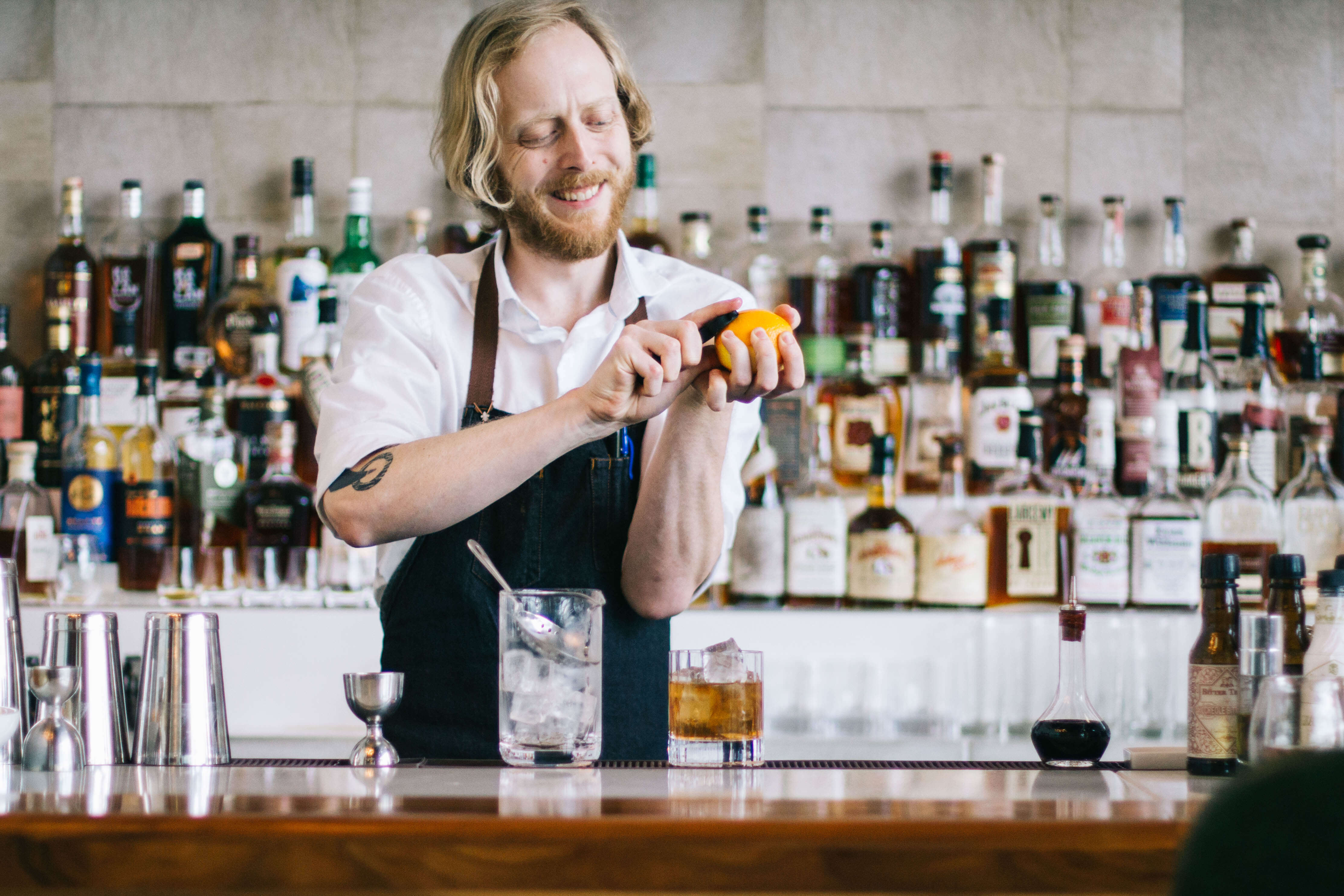 Bartending making a bourbon craft cocktail