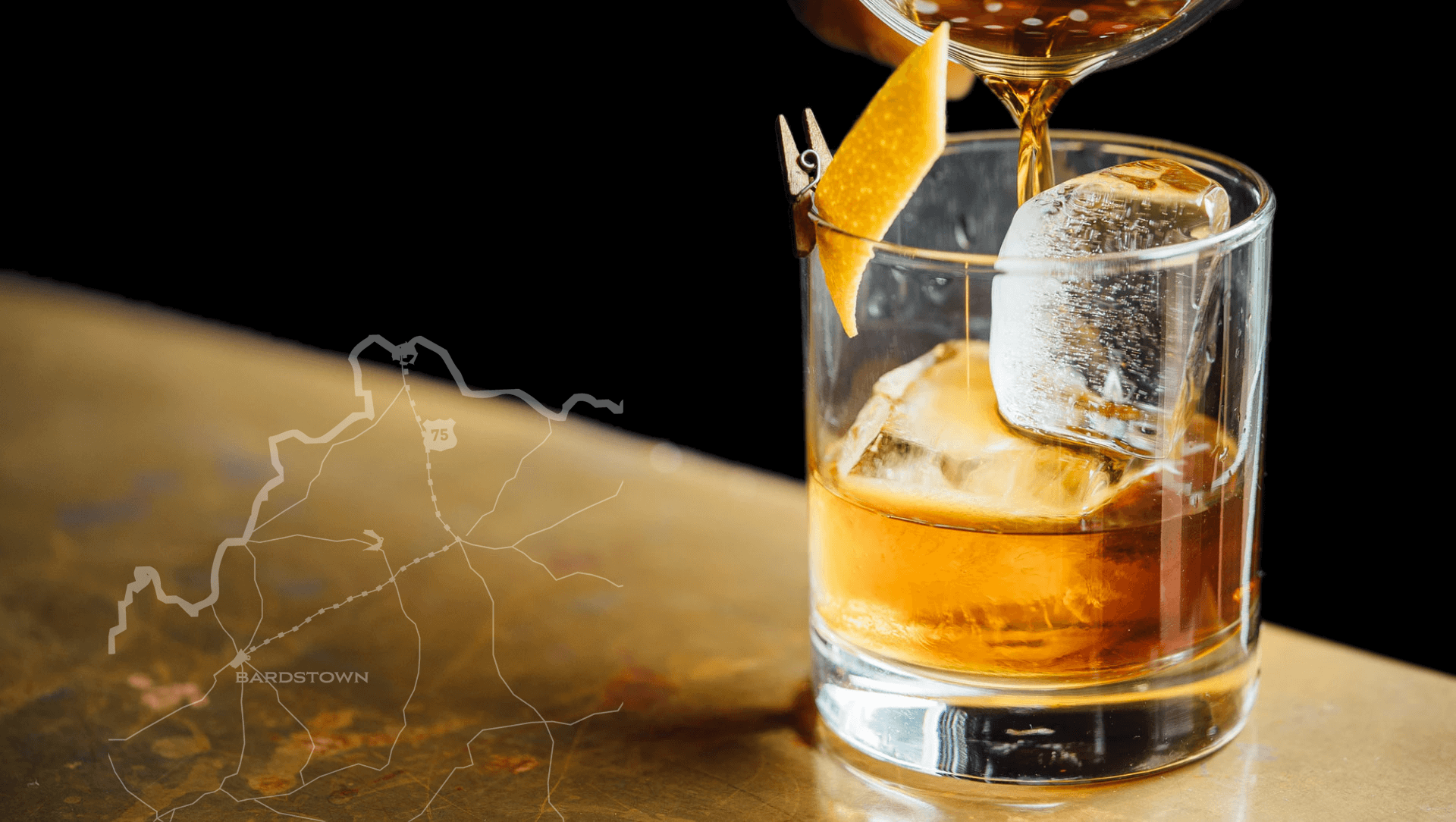 Map of Bardstown overlaid on image with bourbon on the rocks drink
